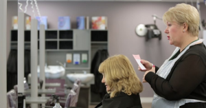 Image of a hairdresser talking to a client
